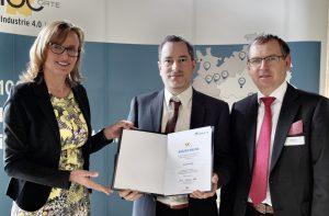 Dr. Dieter Braun und Michael C. Krutwig PhD nehemen Auszeichnung entgegen