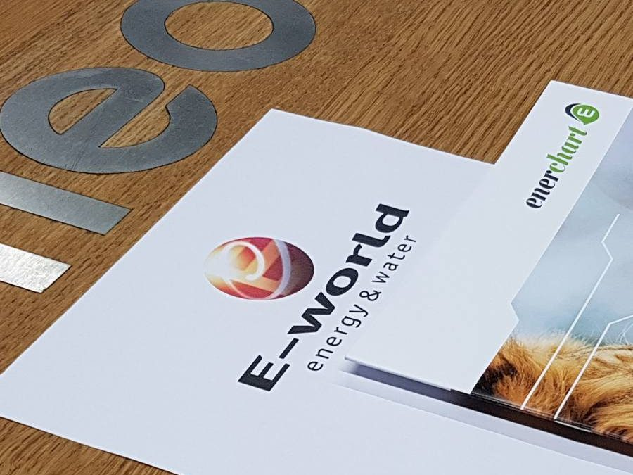 Picture of e-world flyer with enerchart booklet on top